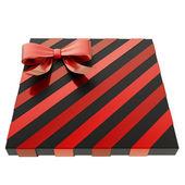 Caixa de presente embrulhado com um arco e fita — Foto de Stock
