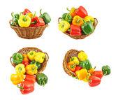 Wicker basket full of bell peppers — Stock Photo
