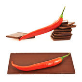 Chocolate and chili pepper composition — Stock Photo