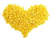 Heart shape made of corn kernels isolated — Stock Photo