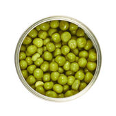 Metal can full of green peas isolated — Stock Photo