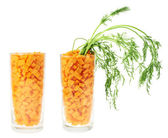 Glass full of carrot pieces isolated — Stock Photo