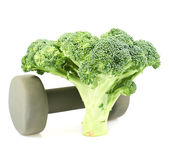 Green broccoli next to a dumbbell — Stock Photo