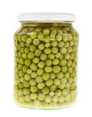 Glass jar full of green peas — Stock Photo