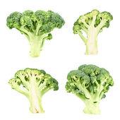 Cutaway and whole green broccoli — Stock Photo