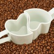 Two empty cups on coffee beans — Stock Photo #47857137