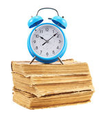 Alarm clock on the stack of books — Stock Photo