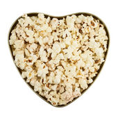 Heart shaped box full of popcorn — Stock Photo