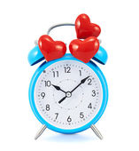 Red hearts over the alarm clock — Stock Photo