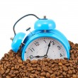 Blue alarm clock buried in beans — Stock Photo