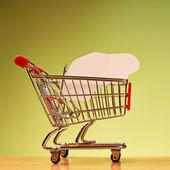 Car shape inside shopping cart — Stock Photo
