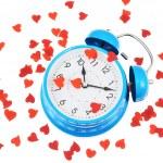 Alarm clock covered with hearts — Stockfoto #49957425