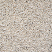 Grainy wall surface fragment — Stock Photo