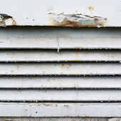 Old rusty ventilation grille fragment — Stock Photo