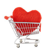 Plush toy heart in a shopping cart — Stock Photo