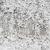Bumpy concrete wall fragment — Stock Photo