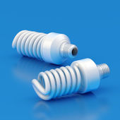 Two energy saving bulbs — 图库照片