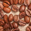 Coffee beans on traditional sack textile — Stock Photo