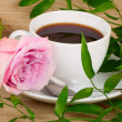 Cup of coffee with rose — Stock Photo #24362963