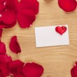 Card and rose petals with a blank space — Stock Photo #24369819