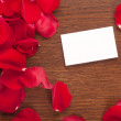 Card and rose petals with a blank space — Stock Photo #24369867
