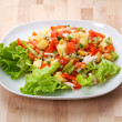 Salad on the kitchen table — Stock Photo
