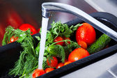 Vegetables are washed in the kitchen sink — Stock Photo