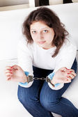 Girl in handcuffs — Stock Photo
