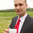 Businessman relaxing outdoor with coffee cup — Stock Photo