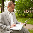 Businessman working with laptop outdoor — Stock Photo