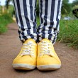 Man in striped pants and orange sneakers — Stock Photo #26672525
