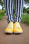 Man in striped pants and orange sneakers — Stock Photo