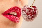 Red lips with cherry in sugar — Stock Photo