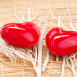 Stock Photo: Red candle in shape of heart on bamboo mat