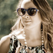 Beautiful young woman in sunglasses — Photo