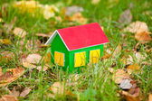 Toy house in grass — Stock Photo