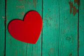 Heart on wood background — Stock Photo