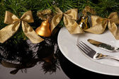 White empty plate with cutlery and Christmas ornaments — Stock Photo