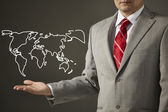 Businessman holding a drawing world map — Stock Photo