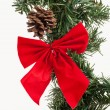 Fir tree branch and red bow — Stock Photo