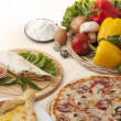 Pita, pizza, vegetables and armenikhachapuri — Stock Photo #28939045
