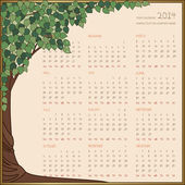 Yearly calendar 2014 in green tree frame — Stock Vector