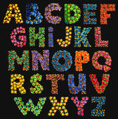 Colorful funny acid alphabet on black — Stock Vector