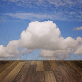 Cloudy blue sky and a wooden floor — Stock Photo