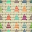 Christmas trees on a brick wall — Stock Vector