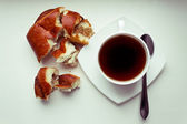 Coffee Cup and Bread Roll — Stock Photo