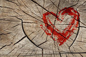 Drawing love symbol on wooden wall — Stock Photo