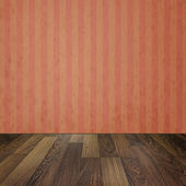 Empty room with wooden floors and vintage striped wallpaper — Stock Photo