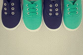 Blue and green shoes on the background with zigzags — Stock Photo
