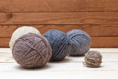 Balls of wool on wooden background — Stock Photo